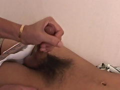 I kept jerking and Tony could not hold back anymore, blowing a biggest load of cum all over his stomach