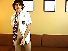 He begins of by taking of his shorts and unbuttoning his uniform, and begins to jerk his super sexy twink dick